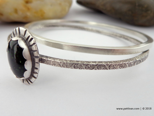 Set of 2 Sterling Silver Bangles with Green Goldstone Focal
